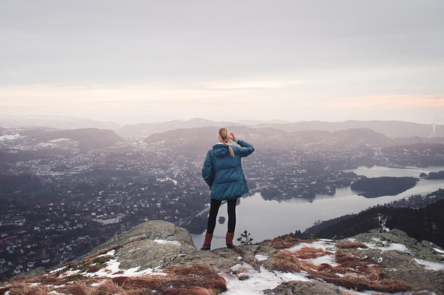 Woman looking at view from top of a mountain